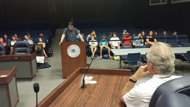Fifteen year old Ben gives his speech. In the foreground is Judge David Dreyer, who was kind enough to spend time with us in the chamber, giving feedback to the campers as they testified.