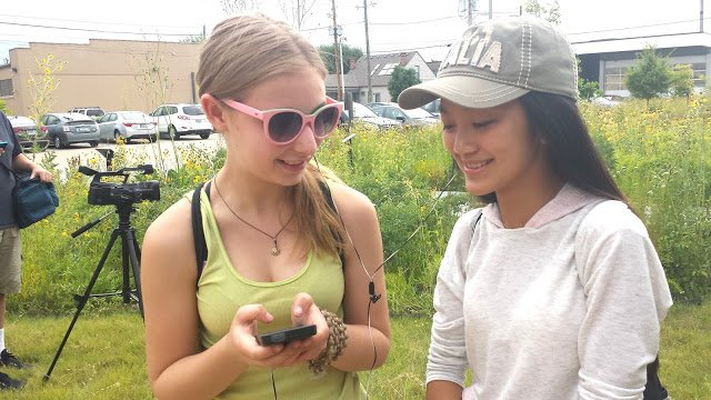 Lucy, left (our portrait artist, see below), and Vanessa, share a tune at The Nature Conservancy.