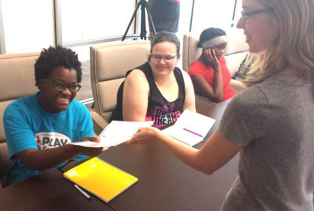 Rachel, left, receives her deed from TNC's Laura Sertic.