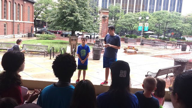 Part of our lunchtime stop at the City Market was a workshop on public speaking, courtesy of two campers well versed in being before the public: Teddy (Tiny Tim in IRT's 'The Christmas Carol') and Ben ('Shrek, The Musical').