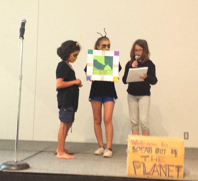 Hikari, Isabelle (dressed for a play about Colony Collapse Disorder) and Hannah created a board game called Reality, modeled loosely on Monopoly, except their game is about human impact and how to restore our eco-system by actions such as planting trees.