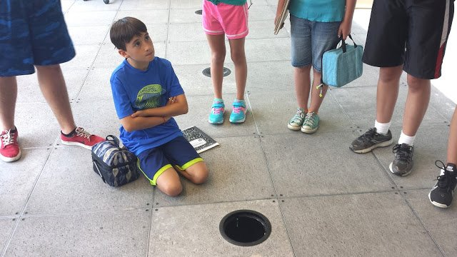 Teddy and other campers learn all about The Nature Conservancy's geothermal system.